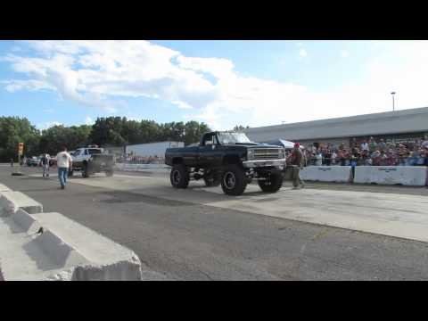 Big Chevy 4x4 Vs White Dodge Tug Of War - North View