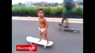 Baby shows off skateboarding skills