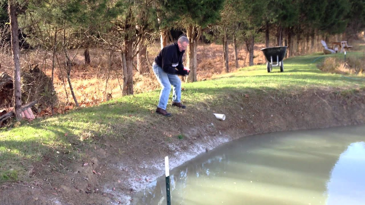 Spreading Bentonite To Fix Leaking Pond Youtube