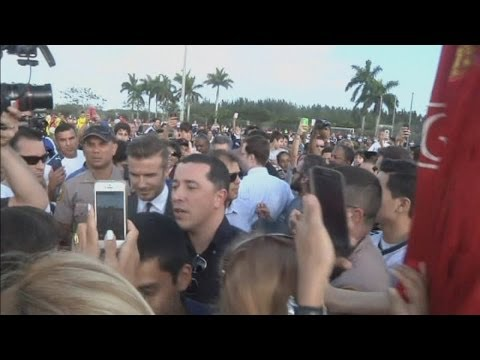 David Beckham mobbed in Miami: Kids football photo-op abandoned