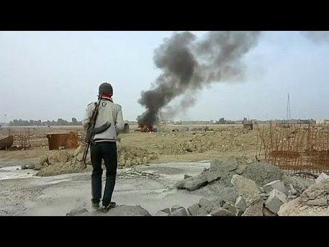 Iraqi forces battle to retake cities from al Qaeda militants