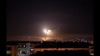 Israel answers Iranian rockets with airstrikes, raising escalation fears