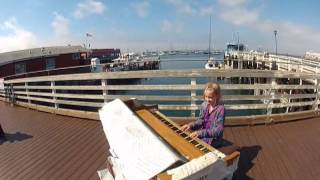 [8yr old girl plays abandoned piano on wharf] Video