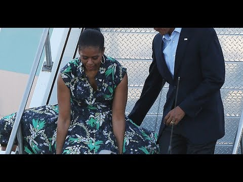 Nice catch, Michelle! Barack is impressed as First Lady narrowly avoids suffering a 'Marilyn' moment
