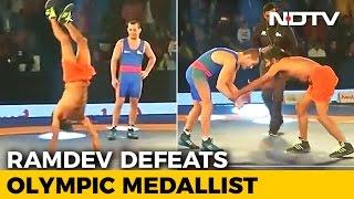 Baba Ramdev Defeats Olympic Medalist Stadnik in Wrestling ..