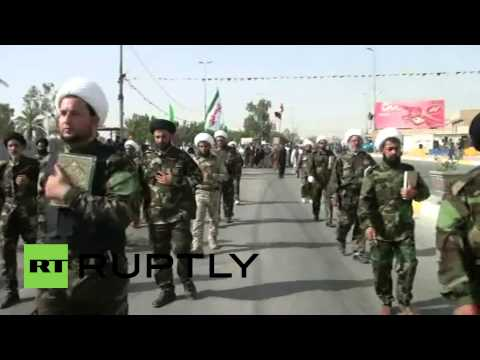 Iraq: Battle-ready Mahdi militants march in the thousands