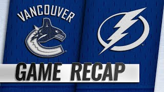 Canucks score four in the 3rd to down Lightning
