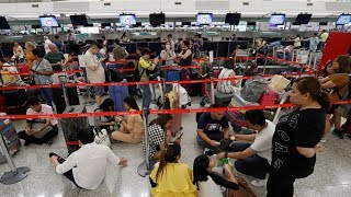 Who is stealing people's freedom at Hong Kong Airport?