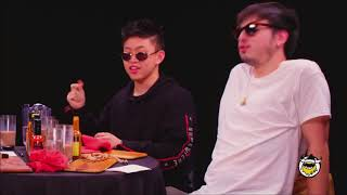 Rich Brian and Joji singing Midsummer Madness on Hot Ones
