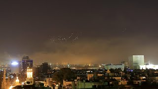 Amateur footage shows missiles falling over Damascus as airstrikes begin