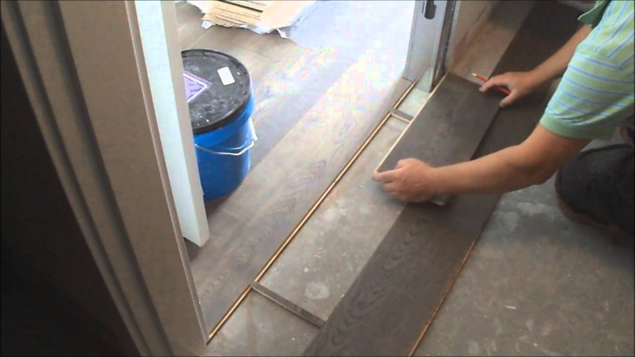 Closet With Laundry Floor Tile And Carpet
