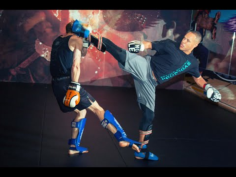 Kickboxing Sparring - How to Set up and Land Spinning Kicks with Raymond Daniels