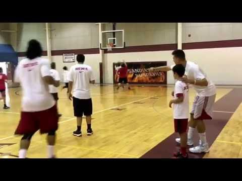 Dairese Gary and Roman Martinez coach at Bairstow basketball camp