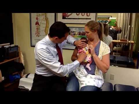 Newborn Baby's First Chiropractic Adjustment by Bellevue Chiropractor Dr. Bob Cummins
