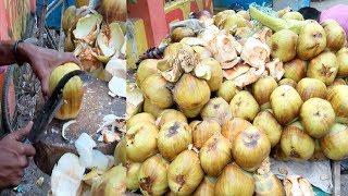 Palm fruits cutting Bangladeshi street fruits Taler Ahari or Tasty Edible jelly seed in Dhaka