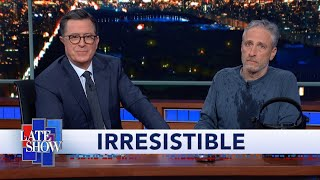 "Jon Stewart Climbs Out From Under Colbert's Desk To Debut ""Irresistible"" Movie Trailer"