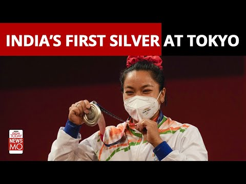 Weightlifter Mirabai Chanu reacts after winning India's first silver at Tokyo Olympics