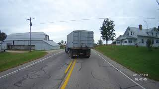 Grain Truck Pulls Out in Front of Loaded 45' Motorcoach