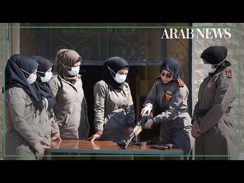 Female police officers on duty side-by-side with male counterparts in Syria's Al-Bab