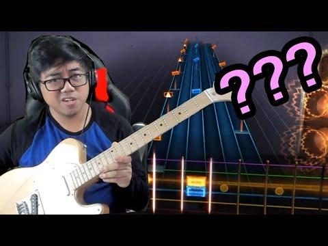 GUITAR HERO PLAYER PLAYS REAL GUITAR???