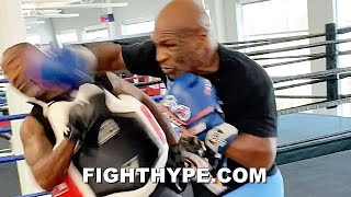 MIKE TYSON NEARLY KNOCKS TRAINER'S HEAD OFF; NEW TRAINING LEAK SHOWS DANGER IN STORE FOR ROY JONES