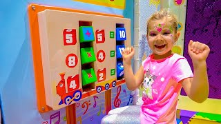 Diana and Roma interact with fun exhibits at the children's museum