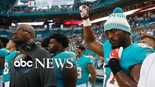 NFL players take a knee, raise fists during national anthem