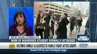 Families in murder case fight near court