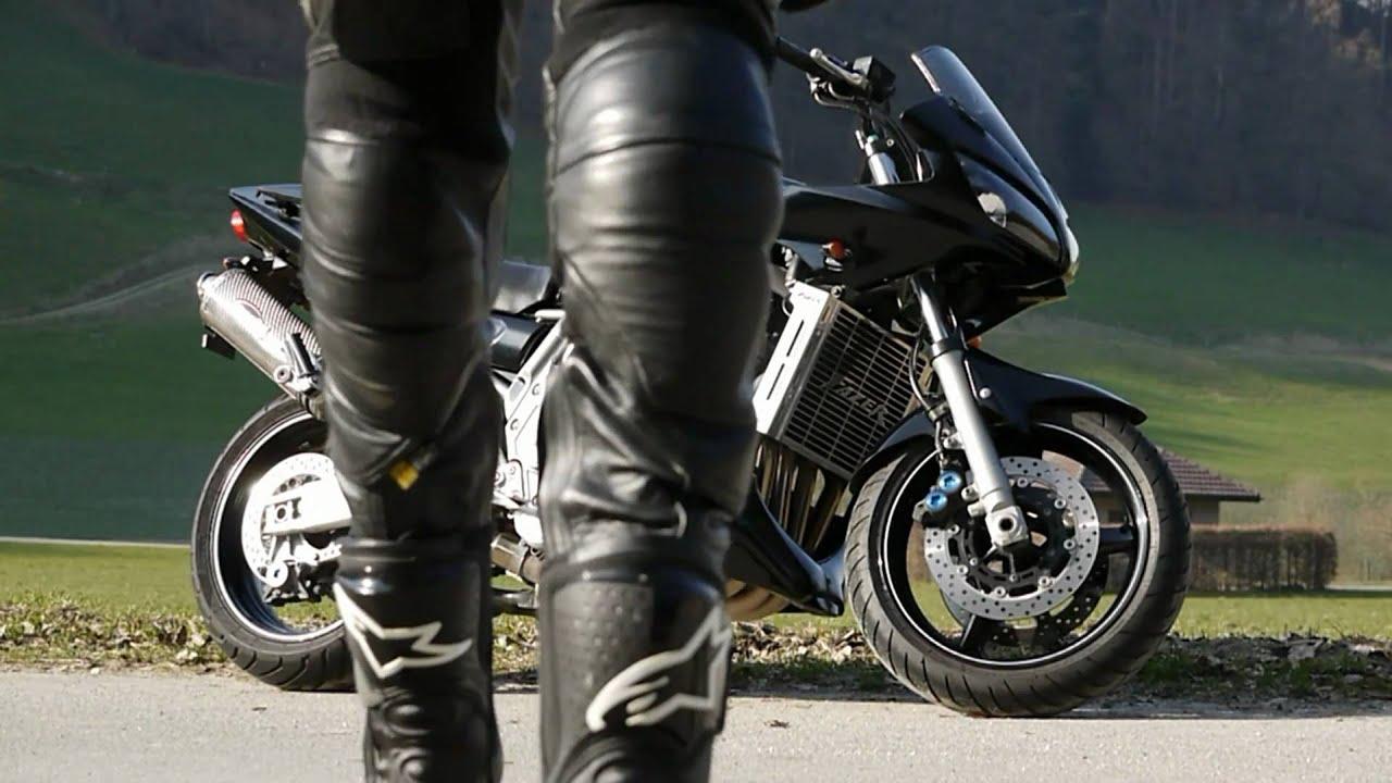 biker leather smoking behind