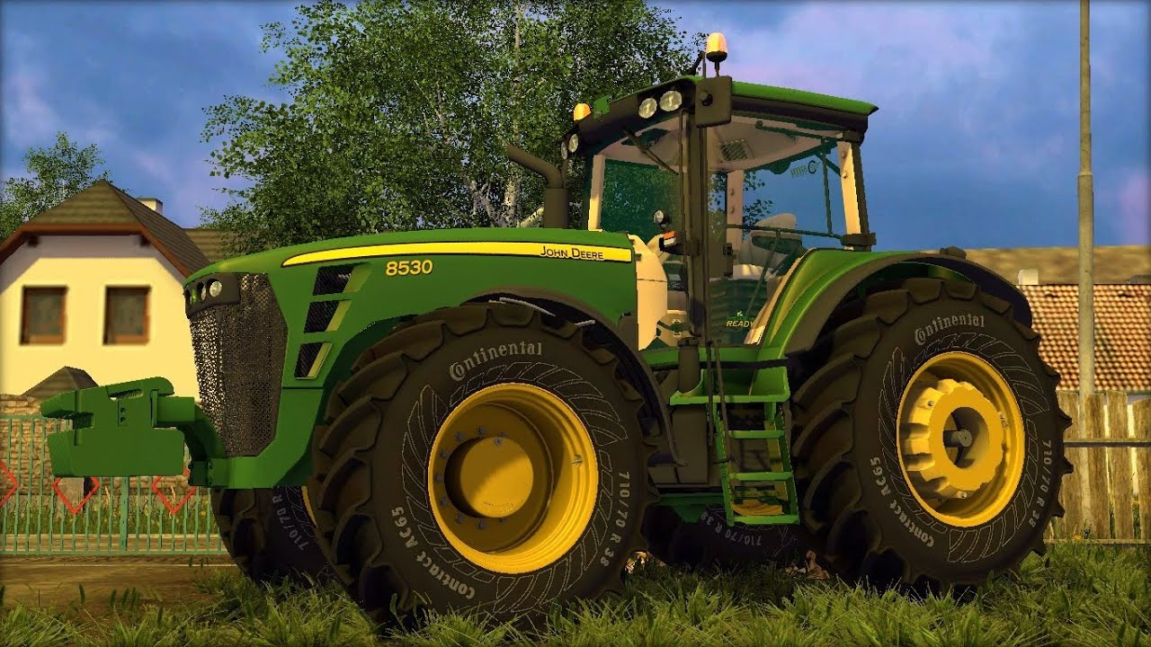 John deere 6310 tractor download large bales and loaded on a.