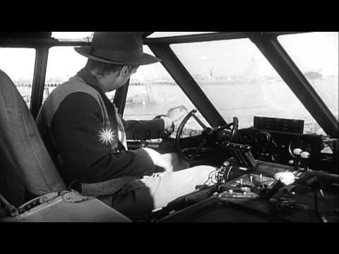 Aviator Howard Hughes flies his H-4 Hercules amphibious plane low above the water...HD Stock Footage
