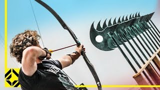 Can You Fire an Arrow through 12 Axes? (Odysseus Archery Challenge)