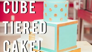 How To Make a FANCY Tiered Cube Cake with blue and cream fondant and gold dust!