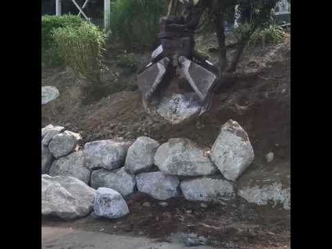 Fitting boulders into a Rock Retaining Wall