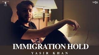 Immigration Hold – Yasir Khan – J Hind