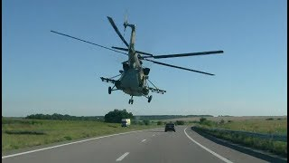 Helicopter Flying Past Cars