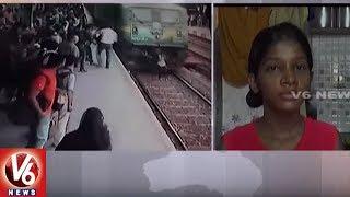فتاة هندية تنجو من الموت بأعجوبة تحت عجلات القطار - فيديو