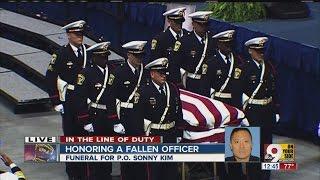 Cincinnati Police Officer Sonny Kim's casket leaves funeral