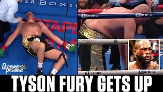 The SHOCKING moment Tyson Fury RISES FROM THE CANVAS after Deontay Wilder thinks he is KNOCKED OUT🤯