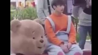 When Jungkook wore the bear costume and can't hand out the flyers to people  of his big paws