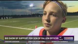 Big show of support for son of fallen officer