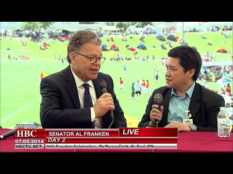 Yia Michael Thao talks with Senator Al Franken at Hmong Freedom Festival