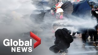 Hong Kong police blasts water cannon at protesters as march erupts into violence