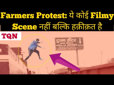 Watch: Protesting farmer jumps onto Police vehicle to switch off water canon