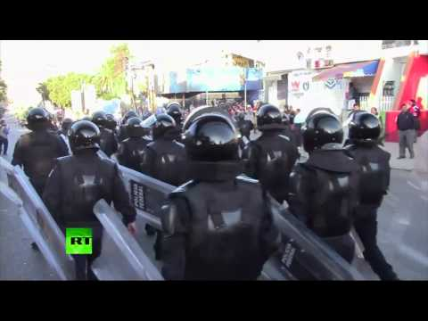Stones & plumes of tear gas as Mexican police clash with dissident teachers