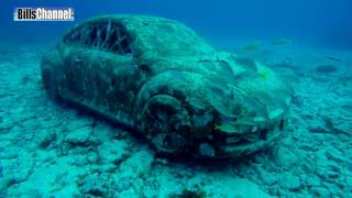 MYSTERY CAR ON SEA FLOOR MAY BE TIED TO MURDER