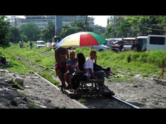 便宜受歡迎 菲國鐵軌人力車違法與火車搶道