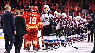 Avalanche and Flames meet at center ice to shake hands after series
