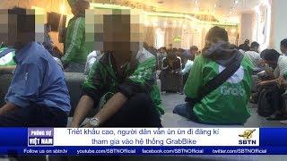 PHÓNG SỰ VIỆT NAM: Người dân Sài Gòn ùn ùn đi đăng ký tham gia hệ thống GrabBike