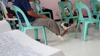 Guy in Church Swings Puppy with His Feet || ViralHog